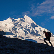 A Man Hiking in the Himalaya Mountains of Tibet