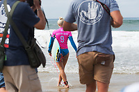 Huntington Beach, CA - August 06: Tatiana Weston-Webb entering the water to compete in the womens semi-finals heat at the Vans US Open of Surfing in Huntington Beach, California on August 6th, 2017. (Photo Jim Kruger/Kruger-images.com)