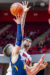 NORMAL, IL - November 03: Phil Fayne reaches to block a shot by Nolan Ebel during a college basketball game between the ISU Redbirds  and the Augustana Vikings on November 03 2018 at Redbird Arena in Normal, IL. (Photo by Alan Look)