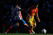 MADRID, SPAIN- MAY 12: (R) Lionel Messi of FC Barcelona  is followed by (L) Koke of Club Atletico de Madrid during the Liga BBVA between Atletico de Madrid and FC Barcelona at the Vicente Calderon stadium on May 12, 2013 in Madrid, Spain. (Photo by Aitor Alcalde Colomer).