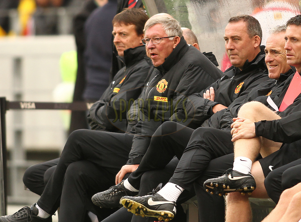 Manchester United manager Sir Alex Ferguson and the Manchester United coaching staff during the Football Invitational 2012 match between Ajax Cape Town and Manchester United held at Cape Town Stadium on 21 July 2012 in Cape Town, South Africa..Photo by Shaun Roy / Sportzpics