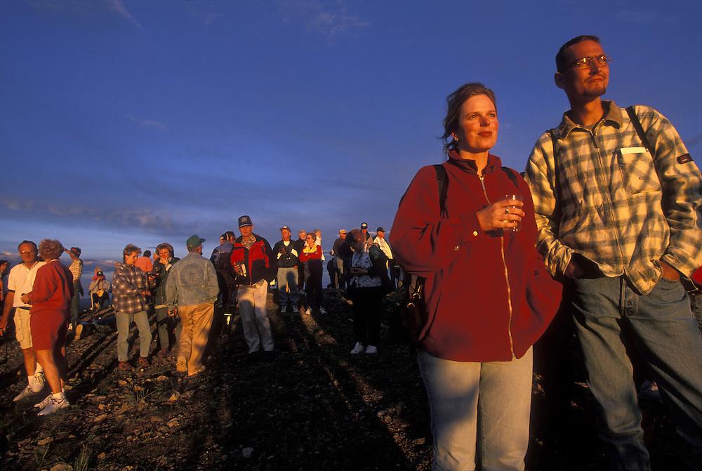 Canada, Yukon Territory., Dawson City, (MR) Henriet Kampman & Egon Breedeveld celebrate solstice on Midnight Dome