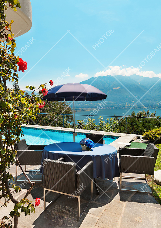 Nice terrace with swimming pool in a house on the lake