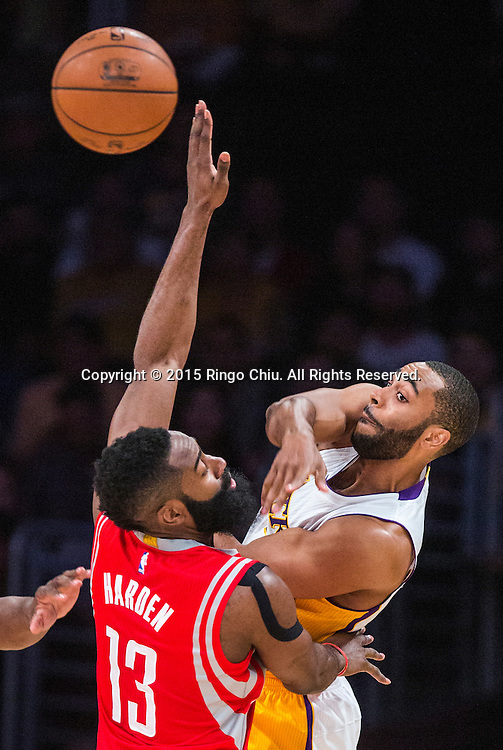 Los Angeles Lakers guard Wayne Ellington (2) passes the ball away from Houston Rockets guard James Harden (13) during their NBA game at Staples Center in Los Angeles, California on January 25, 2015 . Rockets defeated Lakers 99-87. (Photo by Ringo Chiu/PHOTOFORMULA.com)