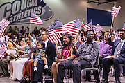 04 JULY 2012 - PHOENIX, AZ:  New US citizens at the naturalization ceremony in Phoenix Wednesday. About 250 people, from 62 countries, were naturalized as US citizens during the 24th Annual Fiesta of Independence naturization ceremony at South Mountain Community College in Phoenix Wednesday. The ceremony was presided over by the Honorable Roslyn O. Silver, Chief United States District Court Judge.   PHOTO BY JACK KURTZ