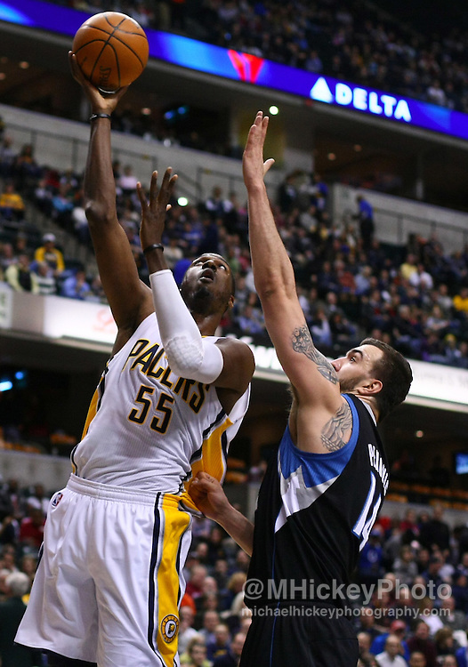 Feb. 11, 2011; Indianapolis, IN, USA; Indiana Pacers center Roy Hibbert (55) puts up a shot against Minnesota Timberwolves center Nikola Pekovic (14) at Conseco Fieldhouse. Mandatory credit: Michael Hickey-US PRESSWIRE