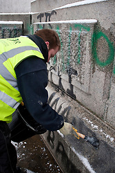 © under license to London News Pictures. 02/12/10. Graffiti from student protests is cleaned from Nelson's Column ahead of Christmas tree lighting ceremony the in Trafalgar Square.  Credit should read Matt Cetti-Roberts/London News Pictures