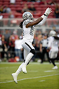 Oakland Raiders outside linebacker Emmanuel Lamur (54) jumps and catches a pass during pregame warmups before the NFL week 9 regular season football game against the San Francisco 49ers on Thursday, Nov. 1, 2018 in Santa Clara, Calif. The 49ers won the game 34-3. (©Paul Anthony Spinelli)