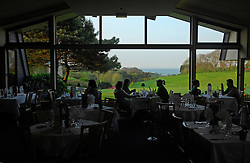 "NORMANDY, FRANCE - MAY-01-2007 - Omaha Beach Golf Club -  The restaurant attached to both the Mercure Hotel and the club house overlooks the green of hole 9 of ""The Sea"" course. (Photo © Jock Fistick)"
