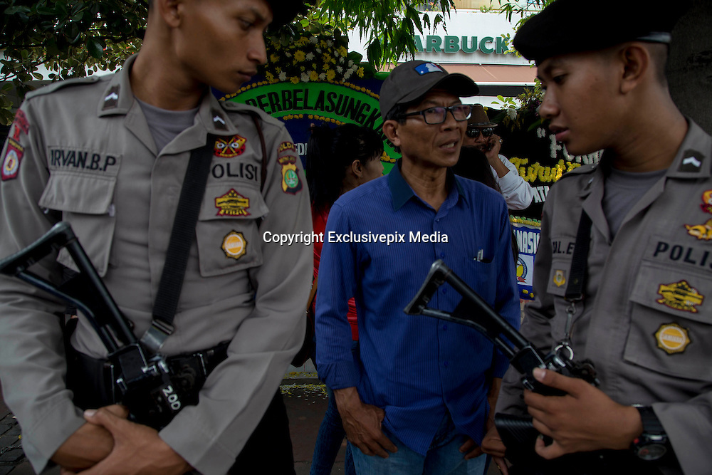 Jakarta, Indonesia 17 January 2016 : <br /> <br /> Police stand guard in front of Starbucks Coffee after the bomb. Jakarta back to normal again after the fatal attack at Starbuck Coffee at Thamrin Street. Peoples still visiting to the bombing site to take photos and condemn to the terrorist action.<br /> ©Exclusivepix Media