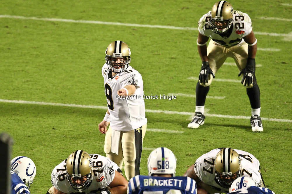 2010 February 07: New Orleans Saints quarterback Drew Brees (9) calls a play from under center during a 31-17 win by the New Orleans Saints over the Indianapolis Colts in Super Bowl XLIV at Sun Life Stadium in Miami, Florida.