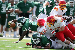19 September 2015:  Maurice Shoemaker-Gilmore gets wrapped up by Isaac Frazier during an NCAA division 3 football game between the Simpson College Storm and the Illinois Wesleyan Titans in Tucci Stadium on Wilder Field, Bloomington IL