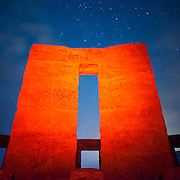 Rock monolith at Stonehenge, Maryhill, Washington.  Light-painted with red gel during 25- to 30-second exposure. Nikon D700, 20/2.8D.
