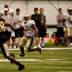 08 August 2009: Rookie running back Herb Donaldson (40) runs with the ball during the New Orleans Saints annual training camp Black and Gold scrimmage held at the team's indoor practice facility in Metairie, Louisiana.