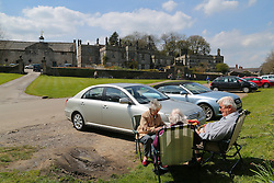 © Licensed to London News Pictures. 05/05/2016. Tissington, UK.  Day trippers enjoy the sunshine whilst eating their lunch in the Derbyshire village of Tissington. Britain is set to see a heatwave this weekend with temperatures reaching the mid twenties. Photo credit : Ian Hinchliffe/LNP