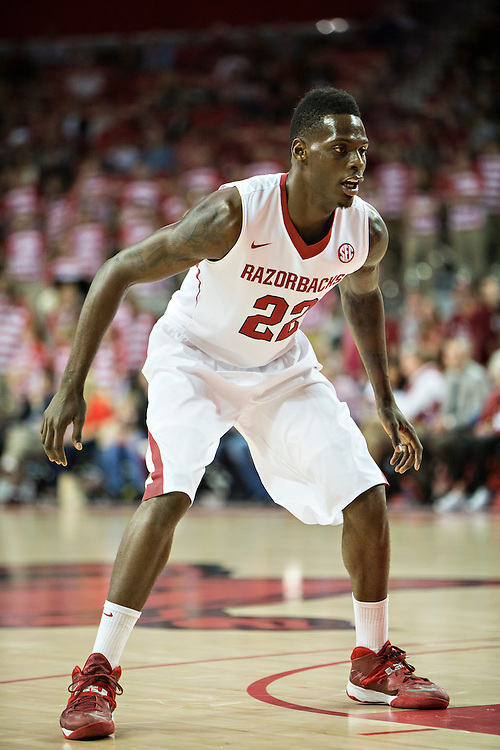 FAYETTEVILLE, AR - NOVEMBER 18:  Jacorey Williams #22 of the Arkansas Razorbacks plays defense against the SMU Mustangs at Bud Walton Arena on November 18, 2013 in Fayetteville, Arkansas.  The Razorbacks defeated the Mustangs 89-78.  (Photo by Wesley Hitt/Getty Images) *** Local Caption *** Jacorey Williams