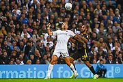 Leeds United midfielder Kalvin Phillips (23) and Brentford forward Bryan Mbuemo (19) in action during the EFL Sky Bet Championship match between Leeds United and Brentford at Elland Road, Leeds, England on 21 August 2019.