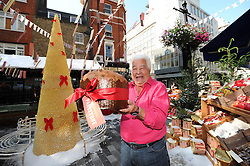 Heatwave Christmas.<br /> In the picture: Antonio Carluccio.<br /> It may be scorching hot but that hasn't stopped the snow falling at Carluccio's as they unveil their 2013 Christmas collection. Let's hope the Christmas Tree made from 5352 conchiglie pasta shells doesn't cook in the sun!<br /> <br /> Antonio Carluccio cools off in the london heatwave by creating christmas outside his restaurant complete with a christmas tree made of 5352 pasta shells.<br /> London, United Kingdom<br /> Thursday, 18th July 2013<br /> Picture by Matthew  Power / i-Images