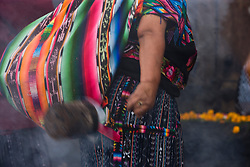 Mayan woman swinging incense in front of Santo Tomás Chichicastenango (church), Chichicastenango, Guatemala