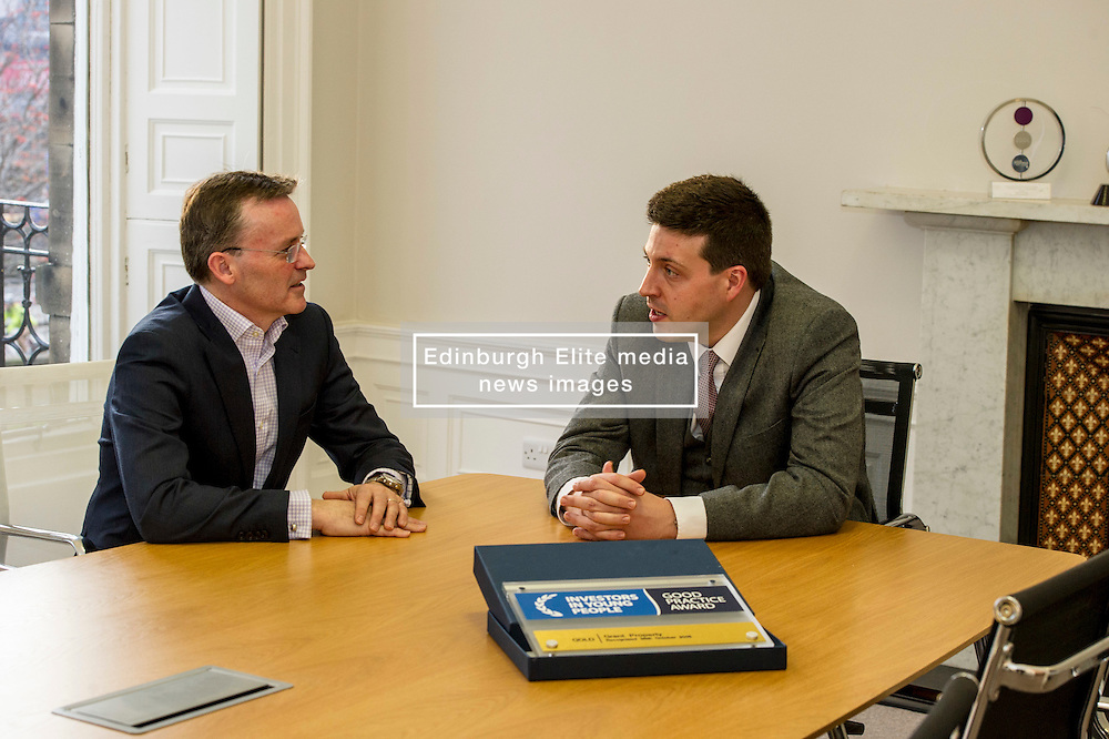 Pictured: Jamie Hepburn and John Moran, managing director Grant Properties<br /> <br /> Employability and training minister Jamie Hepburn MSP, visited Grant Property in Edinburgh today to announce the latest labour market statistics and to award the company the 350th Investors in Young People award. <br /> <br /> Ger Harley   EEm 14 December 2016