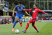 Lyle Taylor forward for AFC Wimbledon (33) and Crawley Town Defender Charles Dunne (31) tussle during the Sky Bet League 2 match between AFC Wimbledon and Crawley Town at the Cherry Red Records Stadium, Kingston, England on 16 April 2016. Photo by Stuart Butcher.
