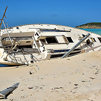 Capsized Sailboat Buried into Sand at Dickenson Bay in St. John&rsquo;s, Antigua<br />