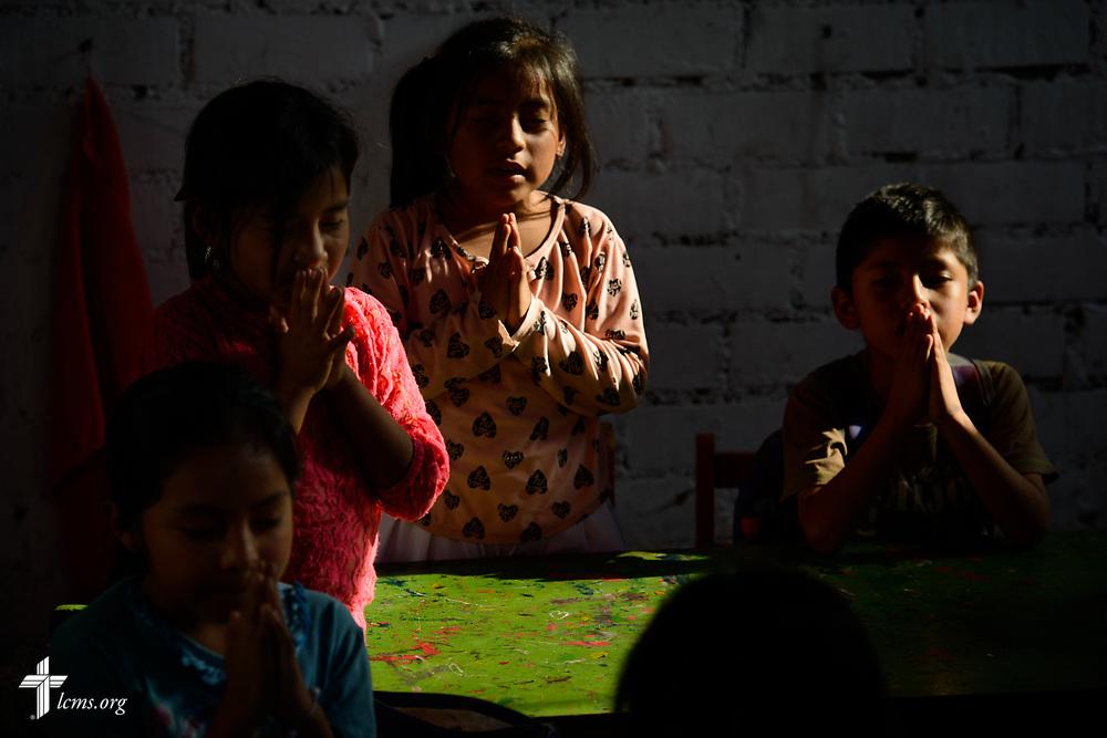 Children pray at Castillo Fuerte in San Juan de Lurigancho on Tuesday Nov. 7 2017, in Peru.  LCMS Communications/Erik M. Lunsford