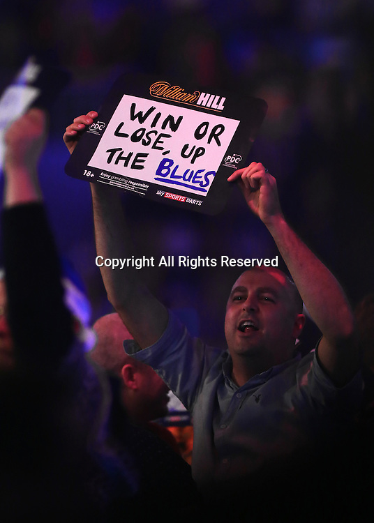 23.12.2016. Alexandra Palace, London, England. William Hill PDC World Darts Championship. A fan holds up a Blues banner