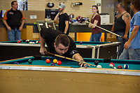 Top US professional pool player Mike Dechaine lines up his shot during the Harley Davidson's Pool Tournament with Tavern Player's on Sunday afternoon to benefit the Childrens Auction.  (Karen Bobotas/for the Laconia Daily Sun)