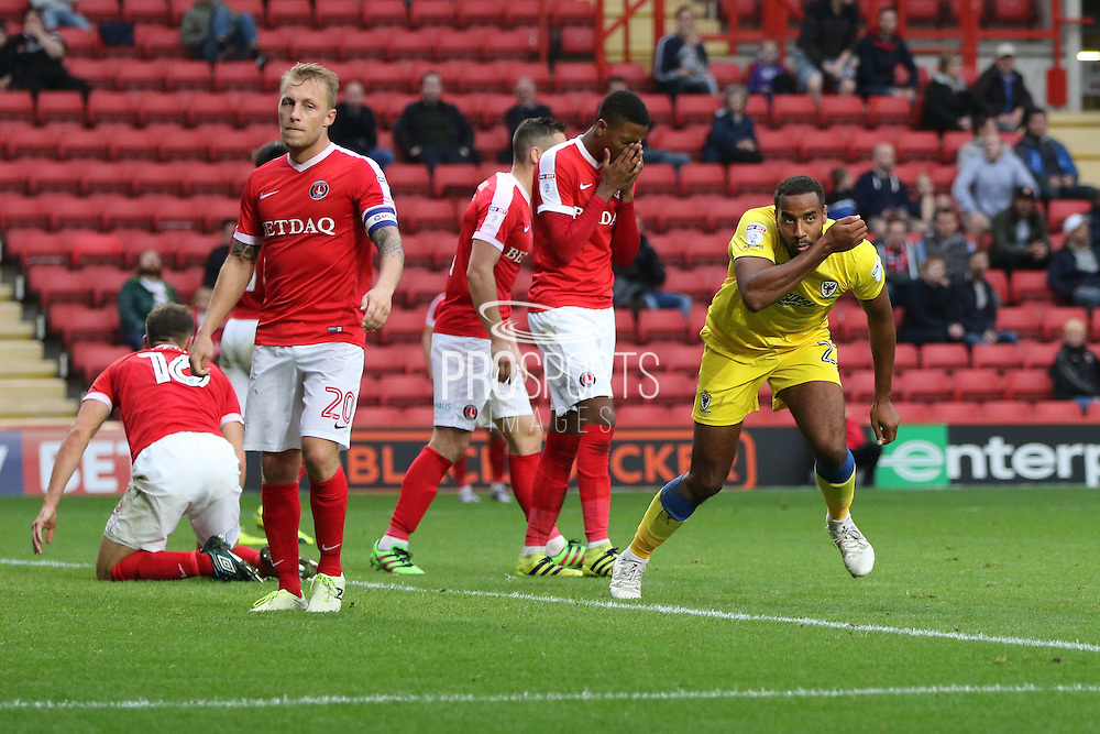 AFC Wimbledon striker Tyrone Barnett (23) scores a goal 1-2 and celebrates during the EFL Sky Bet League 1 match between Charlton Athletic and AFC Wimbledon at The Valley, London, England on 17 September 2016. Photo by Stuart Butcher.