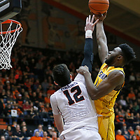 California's Jaylen Brown, right, is fouled by Oregon State's Drew Eubanks in the first half of an NCAA college basketball game, in Corvallis, Ore., on Saturday, Jan. 9, 2016. (AP Photo/Timothy J. Gonzalez)