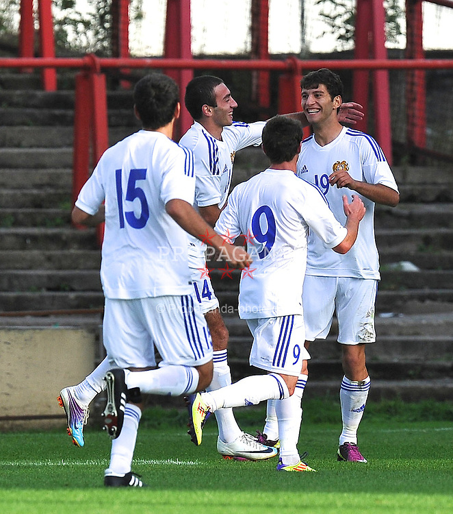 WREXHAM, WALES - Wednesday, August 15, 2012: Armenis's Hovannes Hambarzumyan celebrates his goal from the pen spot during the UEFA Under-21 Championship Qualifying Round Group 3 match against Armenia at the Racecourse Ground. (Pic by Dave Richards/Propaganda)