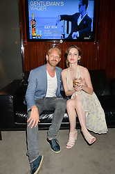 The UK Premier of Johnnie Walker Blue Label's 'Gentleman's Wager' - a short film starring Jude Law was held at The Bulgari Hotel & Residences, 171 Knightsbridge, London on 22nd July 2014.<br /> Picture Shows:-COSIMA BELLAMACINA and ALASTAIR GUY.