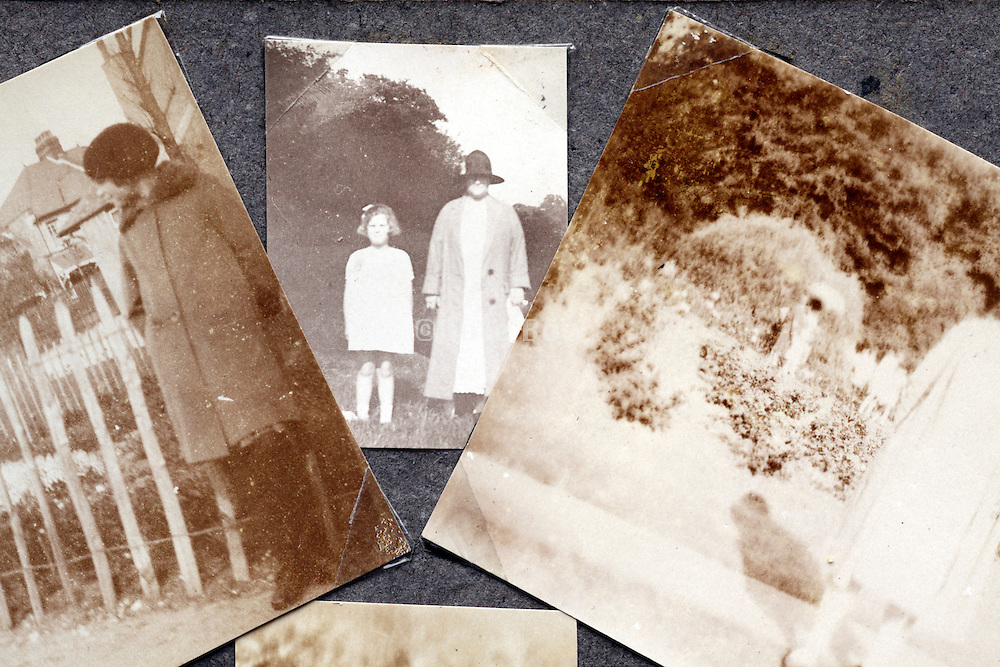 close up of fading images in photo album page early 1900s