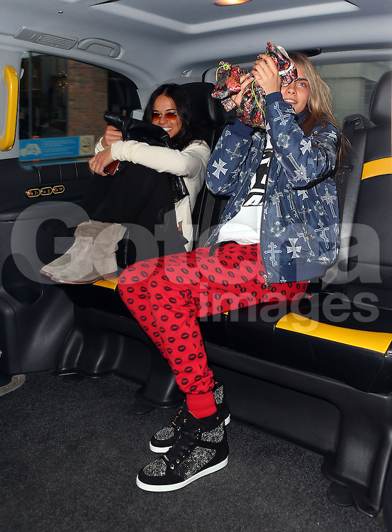 Model Cara Delevingne and girlfriend actress Michelle Rodriguez visit Storm Models management in London, UK. 06/03/2014<br />
