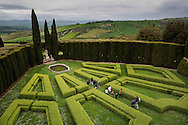 Italy, La Foce - Visitors walk through the gardens of La Foce property. The garden is a perfect example of an italian garden with its geometrical structure. It is considered among the twenty most beautiful gardens of Italy.<br /> Ph. Roberto Salomone