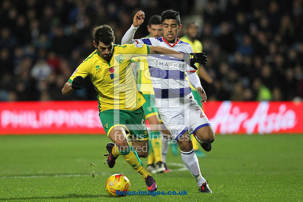 Nelson Oliveira of Norwich and Massimo Luongo of Queens Park Rangers in action during the Sky Bet Championship match at the Loftus Road Stadium, London<br /> Picture by Paul Chesterton/Focus Images Ltd +44 7904 640267<br /> 19/11/2016