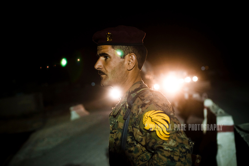 AL HAMDANIYAH, IRAQ - JUNE 02: A Kurdish Peshmerga soldier mans a checkpoint, on June 2 , 2010, in Al Hamdaniyah, east of Mosul, Iraq. Iraq faces multiple challenges in the lead-up to the drawn-down of US forces in Iraq, with many observers claiming that while they have the capablities of handling home-grown problems, they are far from being able to tackle external threats. Political wrangling has reportedly fostered greater instability throughout the country with fears of renewed sectarian violence breaking out as insurgents set-up attacks in an attempt to exploit vulnerabilities amongst the populace. (Photo by Warrick Page)