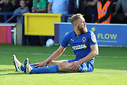 AFC Wimbledon midfielder Scott Wagstaff (7) sat on the floor looking at the linesman during the EFL Sky Bet League 1 match between AFC Wimbledon and Sunderland at the Cherry Red Records Stadium, Kingston, England on 25 August 2018.