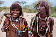Smiling women from the Hamar tribes of southern Ethiopia.