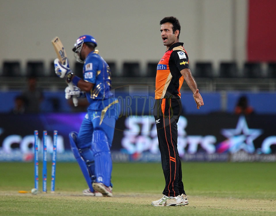 Irfan Pathan of the Sunrisers Hyderabad celebrates the wicket of Kieron Pollard of the Mumbai Indians during match 20 of the Pepsi Indian Premier League Season 2014 between the Mumbai Indians and the Sunrisers Hyderabad held at the Dubai International Stadium, Dubai, United Arab Emirates on the 30th April 2014<br /> <br /> Photo by Ron Gaunt / IPL / SPORTZPICS