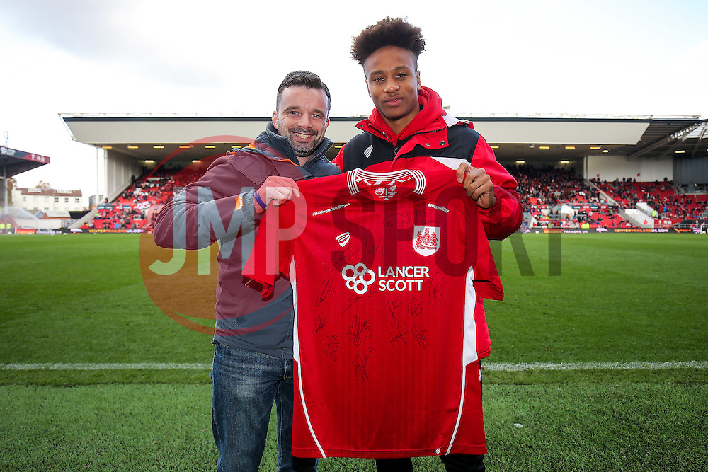 Bobby Reid of bristol City presents the half time draw signed shirt prize - Rogan Thomson/JMP - 22/10/2016 - FOOTBALL - Ashton Gate Stadium - Bristol, England - Bristol City v Blackburn Rovers - Sky Bet EFL Championship.
