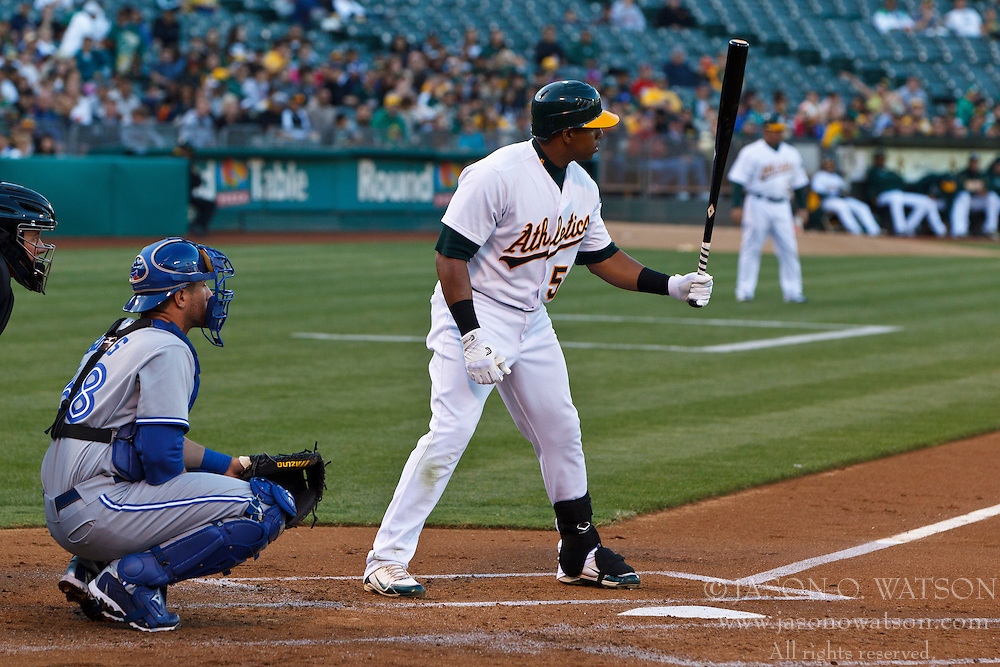 OAKLAND, CA - AUGUST 02: Yoenis Cespedes #52 of the Oakland Athletics at bat against the Toronto Blue Jays during the first inning at O.co Coliseum on August 2, 2012 in Oakland, California. The Oakland Athletics defeated the Toronto Blue Jays 4-1. (Photo by Jason O. Watson/Getty Images) *** Local Caption *** Yoenis Cespedes