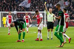 21-01-2018 NED: AFC Ajax - Feyenoord, Amsterdam<br /> Ajax was met 2-0 te sterk voor Feyenoord / Nicolai Jorgensen #9 of Feyenoord, David Neres #7 of AFC Ajax en Bjorn Kuipers geeft geel aan de feyenoorder