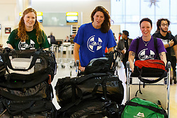 © Licensed to London News Pictures. 22/11/2014. LONDON, UK. NHS Staff (L to R) Angela Mcbride, Annabel Allcorn and Lizzie Marmont join 33 NHS doctors, nurses and paramedics who are leaving Heathrow Terminal 4 for Freetown, Sierra Leone to start working at British-built Ebola treatment centres across the country with the help of GOAL, a Dublin-based international aid agency on UK Government's order. Photo credit : Tolga Akmen/LNP