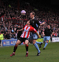 Photo: Tony Oudot/Richard Lane Photography. Brentford v Bury . Coca-Cola Football League Two. 28/02/2009. <br /> Charlie MacDonald of Brentford shields the ball from Ryan Cresswell of Bury