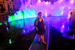 Artist Janet Echelman poses for a photo at the public unveiling of the first section of here site-specific art installation titled Pulse at the Dilworth Park's fountain, on Wednesday.