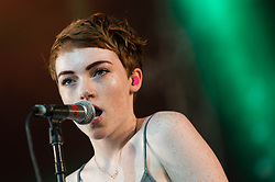 © Licensed to London News Pictures. 13/06/2014. Isle of Wight, UK.   Chloe Howl performing live at Isle of Wight Festival .   Chloe Howl is a British singer-songwriter who was nominated for the BBC Sound of 2014.The Isle of Wight festival is an annual music festival that takes place on the Isle of Wight. Photo credit : Richard Isaac/LNP