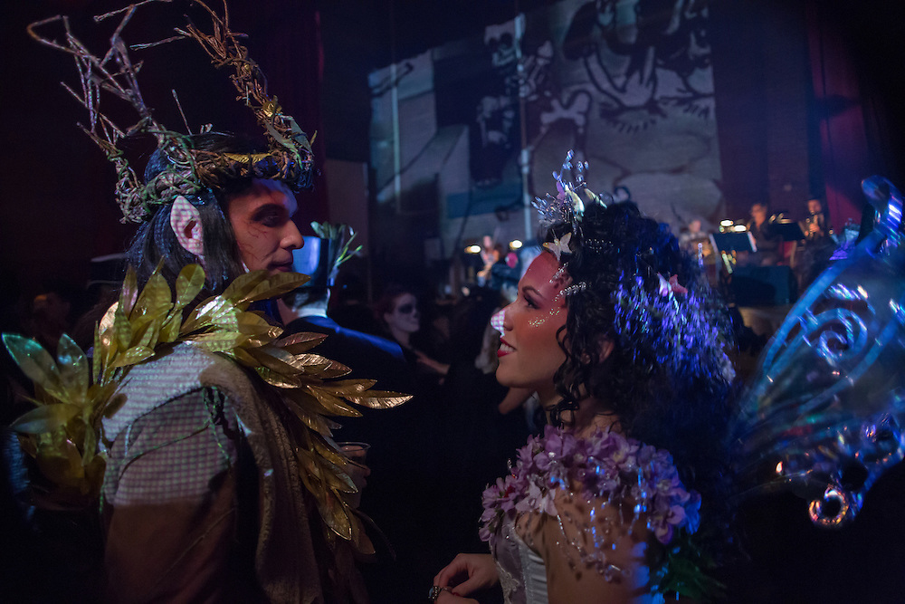 A man costumed possibly as a faun, and a woman costumed as a fairy.