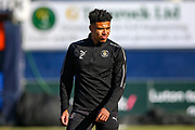 Luton Town defender James Justin warms up ahead of the EFL Sky Bet League 1 match between Luton Town and Coventry City at Kenilworth Road, Luton, England on 24 February 2019.